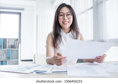 business concept - businesswoman working in office