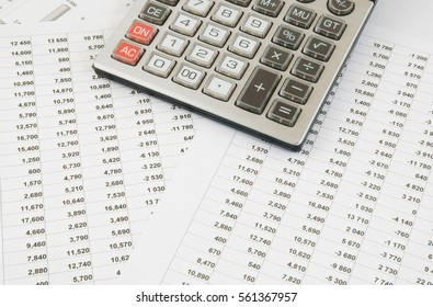 Business concept, calculator on financial documents.