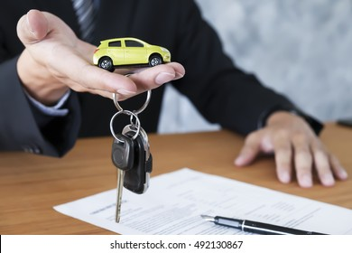 Business concept, car insurance, sell and buy car, car financing, car key for Vehicle Sales Agreement.
