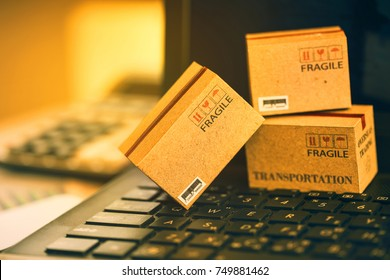 Business concept : cardboard boxes for packing of goods on notebook keyboard. International freight or shipping service for online shopping, e-commerce that can be done easily using an online internet
