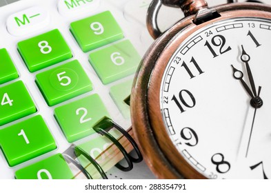 Business concept, clock and calculator with document.