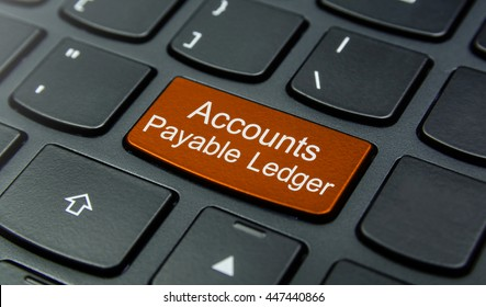 Business Concept: Close-up the Accounts Payable Ledger button on the keyboard and have Orange color button isolate black keyboard