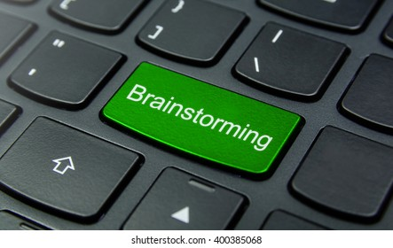 Business Concept: Close-up the Brainstorming button on the keyboard and have Lime, Green color button isolate black keyboard
