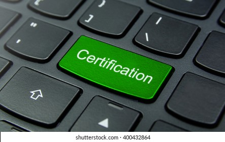 Business Concept: Close-up the Certification button on the keyboard and have Lime, Green color button isolate black keyboard