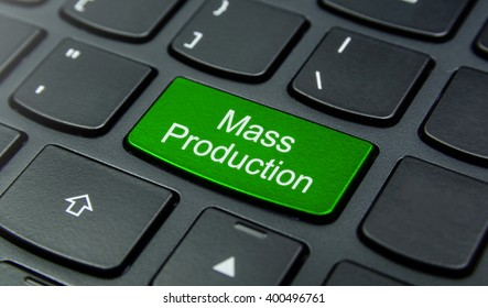 Business Concept: Close-up the Mass Production button on the keyboard and have Lime, Green color button isolate black keyboard