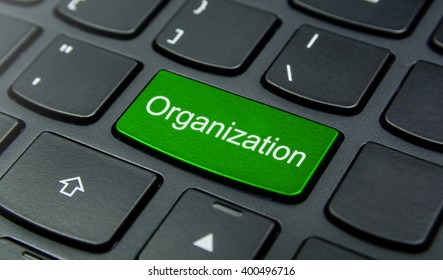 Business Concept: Close-up the Organization button on the keyboard and have Lime, Green color button isolate black keyboard