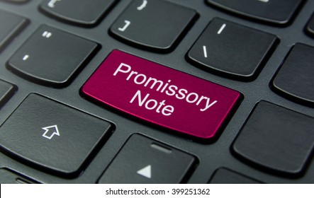 Business Concept: Close-up the Promissory Note button on the keyboard and have Magenta color button isolate black keyboard