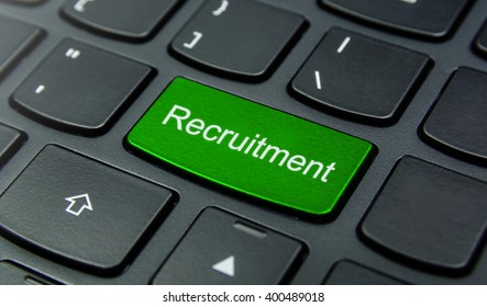 Business Concept: Close-up the Recruitment button on the keyboard and have Lime, Green color button isolate black keyboard