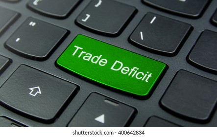 Business Concept: Close-up the Trade Deficit button on the keyboard and have Lime, Green color button isolate black keyboard