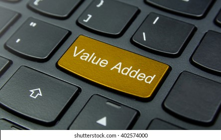 Business Concept: Close-up the Value Added button on the keyboard and have Gold, Yellow color button isolate black keyboard