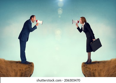 business concept conflict megaphone businessman and businesswoman