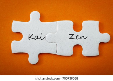 "Business concept and connected puzzle pieces that put the words ""kai""?� meaning ""continuous"" and ""zen""?� meaning ""improvement"" or ""wisdom"". Kaizen is the Japanese strategy of  ""continual improvement"""