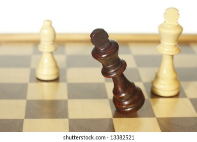 Business concept Defeat in chess battle with white background.