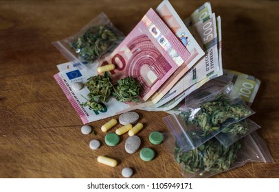 business concept of drug trafficking. Tablets, pills and cannabis lie on cash. money euros and hryvnia illegal.