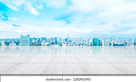 Business concept - Empty marble floor top with panoramic modern cityscape aerial view under sunrise and bright sky of Tokyo, Japan, for display or montage product