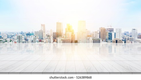 Business concept - Empty marble floor top with panoramic modern cityscape building bird eye aerial view under sunrise and morning blue bright sky of Tokyo, Japan for display or montage product - Shutterstock ID 526389868
