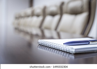 Business concept with empty meetingroom, paper agenda and pen. vintage tone