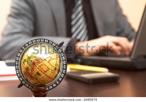 business concept with focus on mini globe