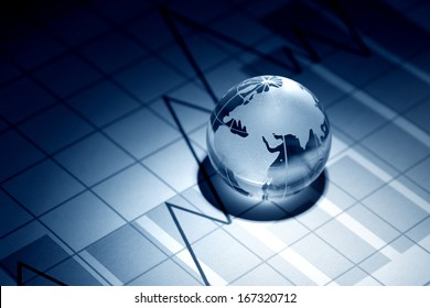 Business concept. Glass globe on background with diagram