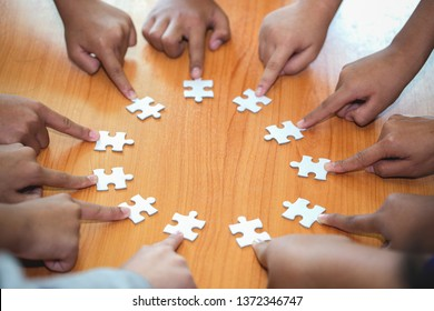 Business concept, Group of business people assembling jigsaw puzzle and represent team support and help togethe