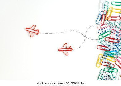 Business concept for group of stacked paperclip with another two red plane paperclips are point to another direction as a team leadership and difference thinking