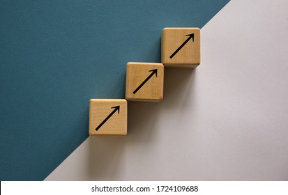 Business concept growth success process. Wood block stacking as step stair on paper blue and white background, copy space.