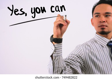 business concept image of businessman hand holding marker and write yes, you can