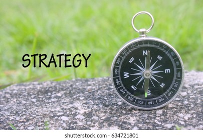 business concept image,compass and word strategy isolated on blurred background.selective focus shot.