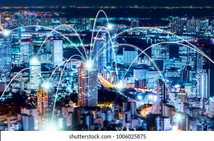 Business concept for information, communication , connection technology - panoramic modern city skyline, bird eye aerial night view under beautiful dark blue night sky in Roppongi Hill, Tokyo, Japan.