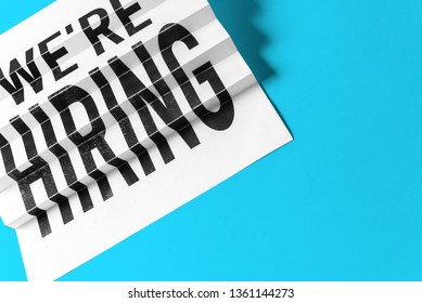 """Business concept of job progress and searching job. Paper stair with text """"we are hiring"""" on blue background."""