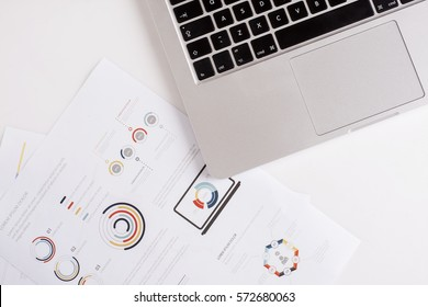 Business concept with lap top and document charts