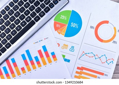 Business Concept with laptop and graph