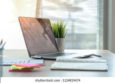 Business concept , Laptop and stationary for marketing and financial work on wood table in office