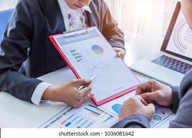 Business concept, Business man and business woman working and meeting with chart at office on his desk, Business People Discussion Teamwork Togetherness Concept..