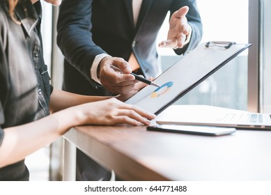 business concept, Business man and business woman working and meeting with chart at office on his desk