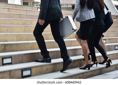 business concept : Business man  and business women walking  up the stair when they go to their office