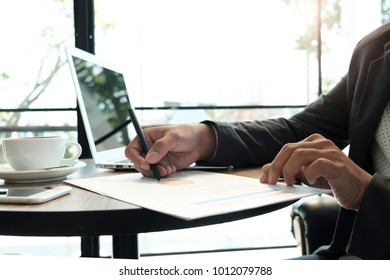 Business concept, Business a man working in coffee shop, light morning