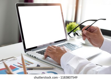 Business concept, Business a man working discussing the charts and graphs showing the results of their successful teamwork, light morning