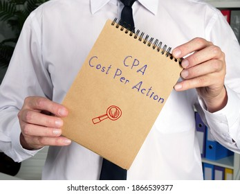 Business concept meaning CPA Cost Per Action k with sign on the sheet.