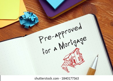 Business concept meaning Pre-approved for a Mortgage with inscription on the page.