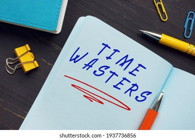 Business concept meaning TIME WASTERS with phrase on the sheet. A person who either consciously or unconsciously tries to engage you in a fruitless investment of your energy