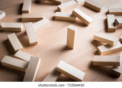 Business concept metaphor to able to survive or dominant from other . One  wood block standing and outstanding among the collapse of other wood block.