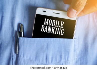 Business concept. Mobile Banking inscription on smartphone screen in businessman pocket. Businessman using smartphone for banking.