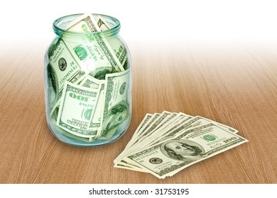 business concept. money in the jar over wooden table