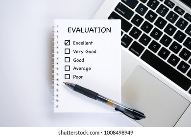 Business concept - Notepad writing EVALUATION with checkbox. Top view design.