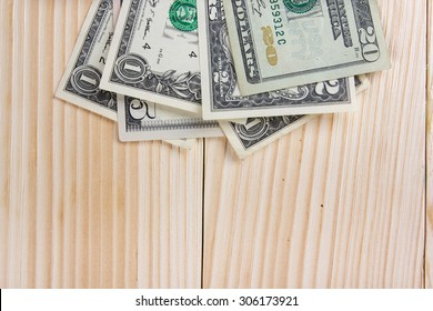 Business concept, office work. Financial Accounting - money on wooden background. Copy space.