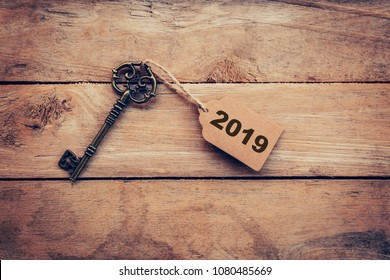 Business concept old key vintage with tag for New Year Resolution 2019.