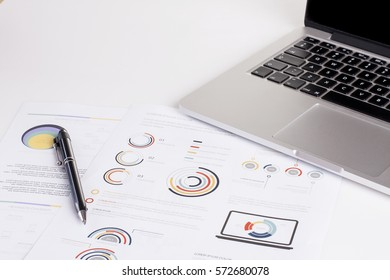 Business concept on a desk with laptop