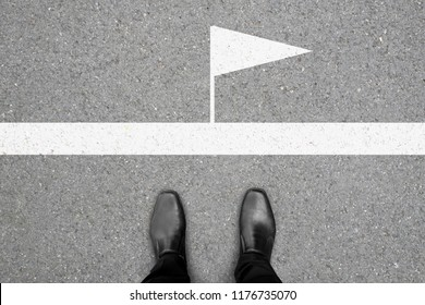 Business concept. One in black shoes standing at the winner line.