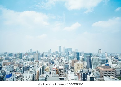Business concept - panoramic modern city skyline bird eye aerial view with spiral tower and midland square under dramatic cloud and morning bright blue sky on Nagoya TV Tower in Nagoya, Japan